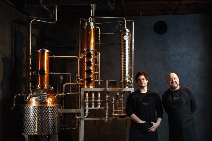 Four Pillars founder & Mixoligist in front of the gin still